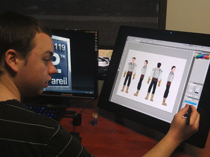 student-daniel-freeman-uses-the-wacom-cintiq-to-make-digital-artwork-during-lunch-at-nonpareil.